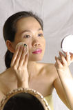 Woman make up in studio. Woman looking into mirror for make up Stock Images