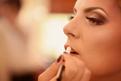 Woman in make-up studio Stock Photography