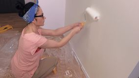 Woman makes apartment renovation. In room stock video