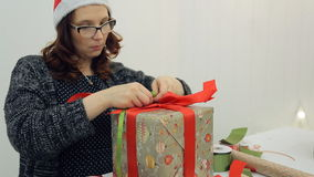 Woman makes bow gifts for Christmas, New Year. stock video footage