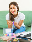 Woman makes braslets with elastic Stock Image