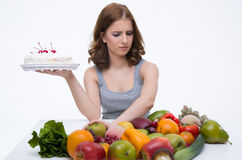 Woman makes choice between cakes Stock Image
