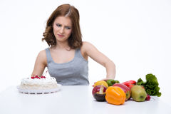 Woman makes choice between cakes Royalty Free Stock Image