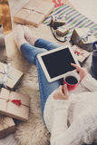 Woman makes christmas shopping online with tablet, above view Stock Photos