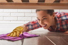Woman makes cleaning. Beautiful young woman makes cleaning the house. Girl rubs dust royalty free stock photography