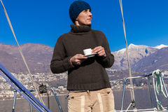 Woman makes a coffee break on the sail boat Royalty Free Stock Photography