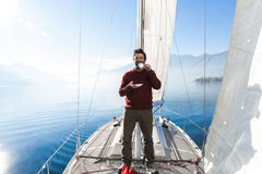 Woman makes a coffee break on the sail boat Stock Photo