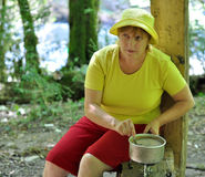 Woman makes coffee on a nature Stock Photos