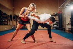 Woman makes elbow kick, self-defense workout royalty free stock images
