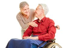 Elderly care at senior man in wheelchair royalty free stock photography