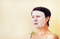 Woman makes facial cosmetic procedures Royalty Free Stock Photography