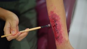 Woman makes fake blood and wounds on arm