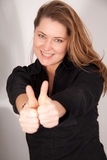 Woman makes gesture with her thumbs Royalty Free Stock Images