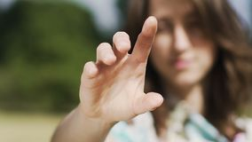 Woman makes gesture of Jesus blessing reached hand, religious move touching. Stock footage stock footage