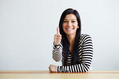 Woman makes the gesture with thumb up Stock Photography