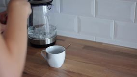 Woman makes her coffee. Process of making coffee at home. Teapot boils. Homemade coffee stock footage