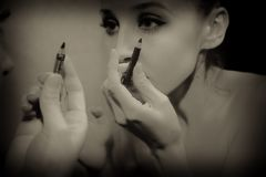 Woman makes herself makeup Royalty Free Stock Photos