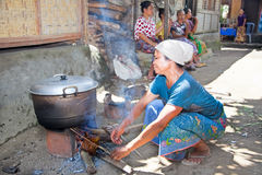 Woman makes Indonesian food at traditional way Royalty Free Stock Image