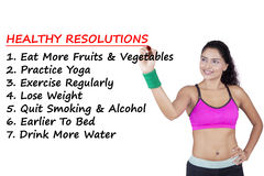 Woman makes the list of healthy resolutions Royalty Free Stock Images