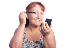 Woman makes makeup Royalty Free Stock Photo