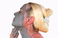 Woman makes a mask from clay Stock Photo