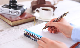 Woman makes a note in a notebook Royalty Free Stock Images