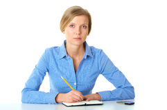 Woman makes notes in her diary, isolated on white Stock Image
