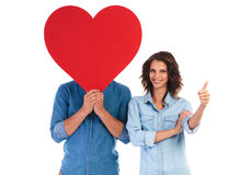 Woman Makes Ok Sign Near Man Covering Face With Heart Royalty Free Stock Photos