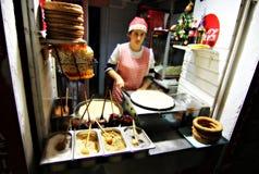 Woman Makes Pancakes Stock Image