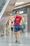 Woman makes phone call in shopping mall, Beijing, China Stock Images