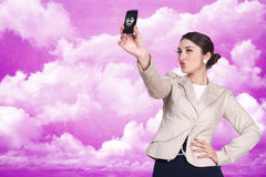Woman makes photography on cellphone Royalty Free Stock Images