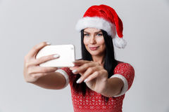 Woman makes photos in hat royalty free stock image