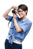 Woman makes photos with retro photographic camera Royalty Free Stock Photos