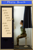 Woman makes the portrait inside photo booth. Royalty Free Stock Photo