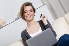 Woman makes purchases through the internet Stock Photos