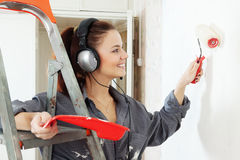 Woman  makes repairs in the apartment Royalty Free Stock Images