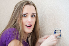 Woman makes repairs electrical outlet Stock Images