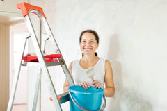 Woman makes repairs at home Royalty Free Stock Images