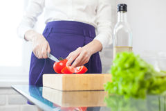 Woman makes a salad Stock Images
