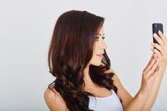 Woman makes a selfie Royalty Free Stock Photo