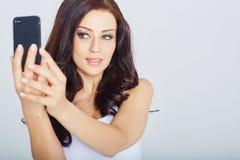 Woman makes a selfie Stock Photos