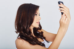 Woman makes a selfie Royalty Free Stock Images
