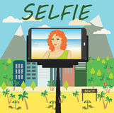 Woman makes selfie using a monopod and a smartphone Royalty Free Stock Photos