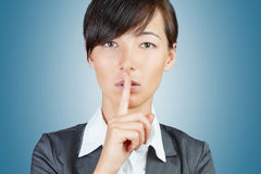 Woman makes silence gesture Royalty Free Stock Image
