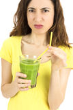 Woman makes a sour face for the smoothie Royalty Free Stock Photos