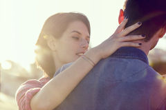 Woman makes a sweet gesture of affection to her man Stock Image