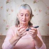 Woman makes testing high blood sugar. Royalty Free Stock Image