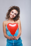 Woman with makeup. Close-up of a young, beautiful, brown-haired woman with red balloon Royalty Free Stock Photos