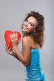 Woman with makeup. Close-up of a young, beautiful, brown-haired woman with red balloon Royalty Free Stock Images