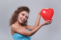 Woman with makeup. Close-up of a young, beautiful, brown-haired woman with red balloon Royalty Free Stock Image